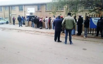 Voting by torch light for Alex residents