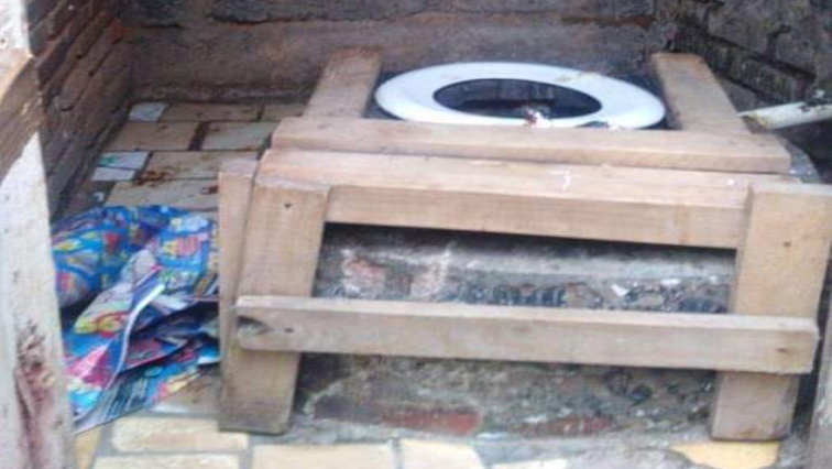 Woman's half naked body found in toilet in Alexandra